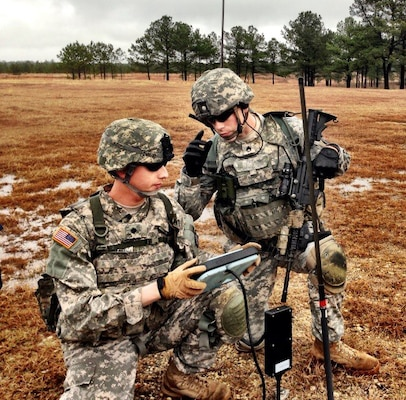 U.S. Army Spc. Michael Piatzer (left), and Staff Sgt. Jacob Wendland operate an unmanned aerial system recently during the Army Expeditionary Warrior Experiment event.