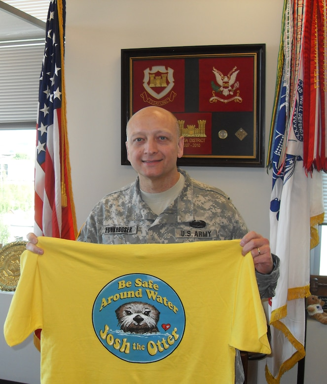 Northwestern Division Commander, Brig. Gen. Anthony C. Funkhouser displays his Josh the Otter t-shirt for National Water Safety Month and the Third Annual Otter Spotter Day.