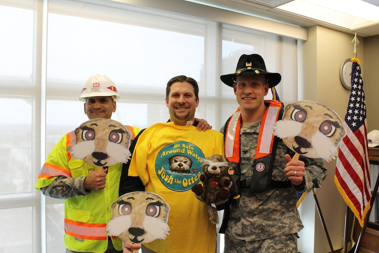 "Omaha District Deputy Commander, Lt. Col. Mark Martinez; Safety Specialist, Jeff Skrivanek; and District Commander, Col. Joel Cross, emphasize workplace, construction and water safety while ""Otter spotting"" for the Josh the Otter Water Safety program."