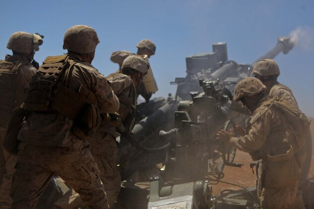 Marines serving with Kilo Battery, 3rd Battalion, 12th Marine Regiment, attached to 2nd Battalion, 11th Marines, reload an M777 Lightweight howitzer during a fire mission here, May 3, 2013. The mission was part of Exercise Desert Scimitar and included division units from 1st Marine Regiment, 5th Marine Regiment, 11th Marine Regiment, 1st Reconnaissance Battalion and 1st Tank Battalion.