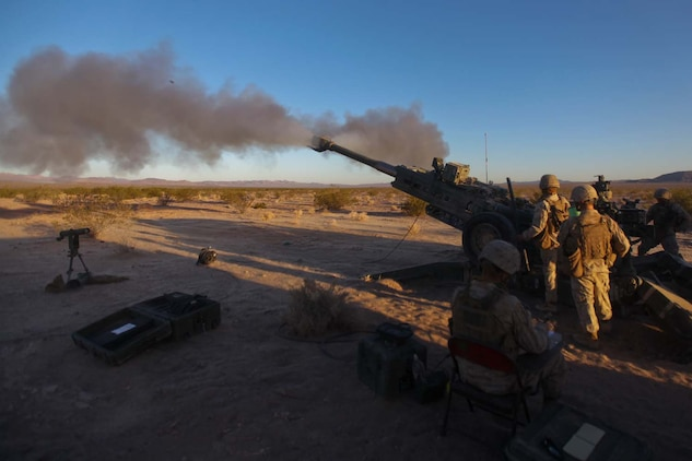 Marines serving with Kilo Battery, 3rd Battalion, 12th Marine Regiment, attached to 2nd Battalion, 11th Marines, launch high-explosive rounds at a target during Exercise Desert Scimitar here, May 3, 2013. The Marines worked 24-hour operations, conducting fire missions and movements throughout the day.