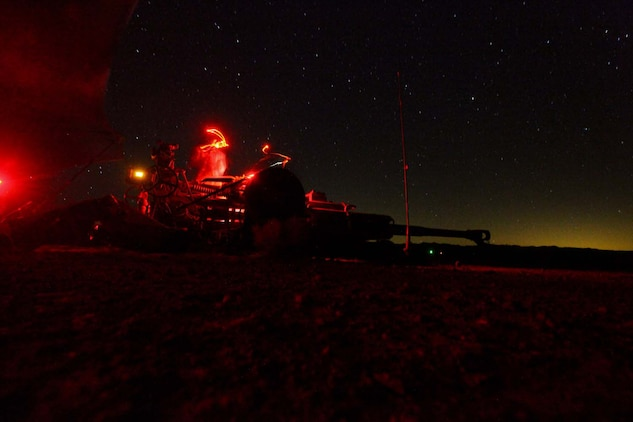 Marines serving with Kilo Battery, 3rd Battalion, 12th Marine Regiment, attached to 2nd Battalion, 11th Marines, lower the barrel of their M777 Lightweight Howitzer, after a night fire mission here, May 3, 2013. The Marines clean the weapon after every fire mission.