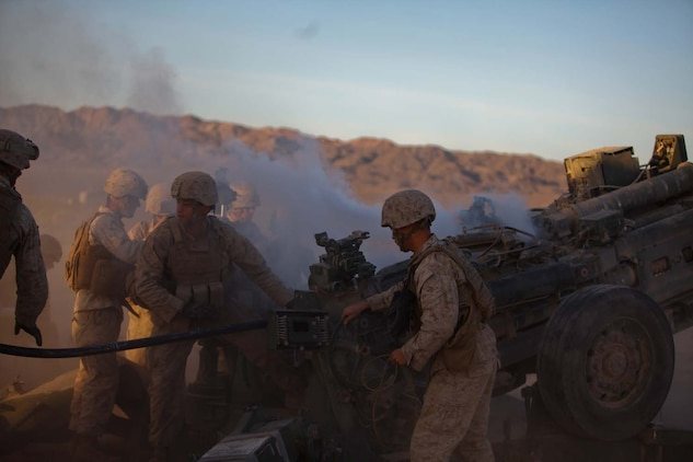 Marines serving with Kilo Battery, 3rd Battalion, 12th Marine Regiment, attached to 2nd Battalion, 11th Marines, prepare to load a round into an M777 Lightweight Howitzer as the smoke clears from an earlier fire here, May 3, 2013. The regiment participated in Exercise Desert Scimitar, focusing on supporting the infantry with high-explosive and illumination rounds.
