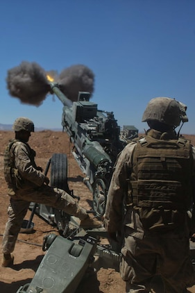 Marines serving with Kilo Battery, 3rd Battalion, 12th Marine Regiment, attached to 2nd Battalion, 11th Marines, fire a high-explosive round from an M777 Lightweight Howitzer during Exercise Desert Scimitar, a combined-arms, live-fire training exercise here, May 3, 2013. Marines with 11th Marine Regiment conducted 24-hour artillery fire missions during the exercise.