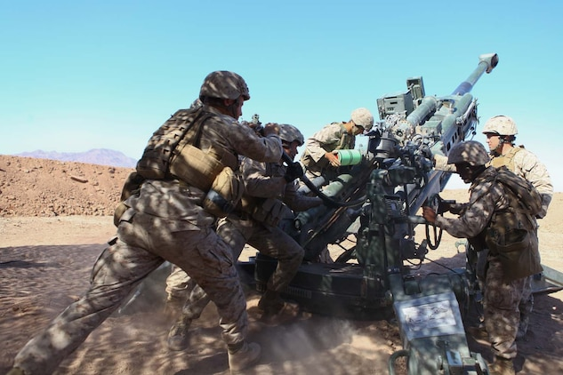 Marines serving with Kilo Battery, 3rd Battalion, 12th Marine Regiment, attached to 2nd Battalion, 11th Marines, load a high explosive round into an M777 Lightweight Howitzer during exercise Desert Scimitar here, May 2, 2013. During the Exercise, Marines participated in 24-hour operations, launching high explosive and illumination rounds.