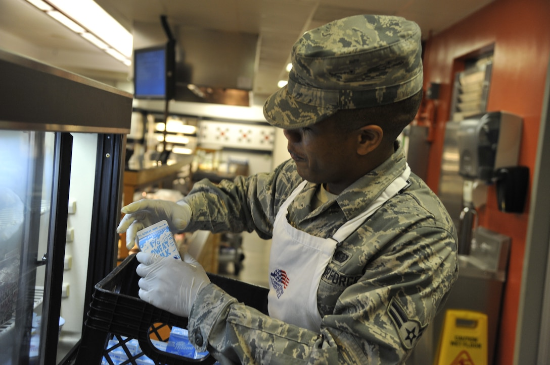 Airman 1st Class Jairzinho Chin, 509th Force Support Squadron services apprentice, restocks milk at the Ozark Inn on Whiteman Air Force Base, Mo. April 15, 2013. Airmen must replenish food supply to ensure customers have a variety of selections. (U.S. Air Force photo by Airman 1st Class Keenan Berry/Released)