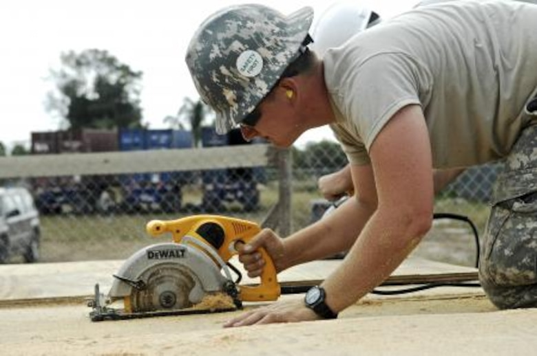 U.S. Army Pfc. Keith Bonnette, assigned to the 1020th Engineer Company, uses a circular saw to cut plywood April 30, 2013, at the Trial Farm Government School construction site in Orange Walk, Belize. Civil engineers from both the U.S. and Belize are constructing various structures at schools throughout Belize as part of an exercise called New Horizons. Building these facilities will support further education for the children of the country and provide valuable training for U.S. and Belizean service members. (U.S. Air Force photo/ Master Sgt. James Law)