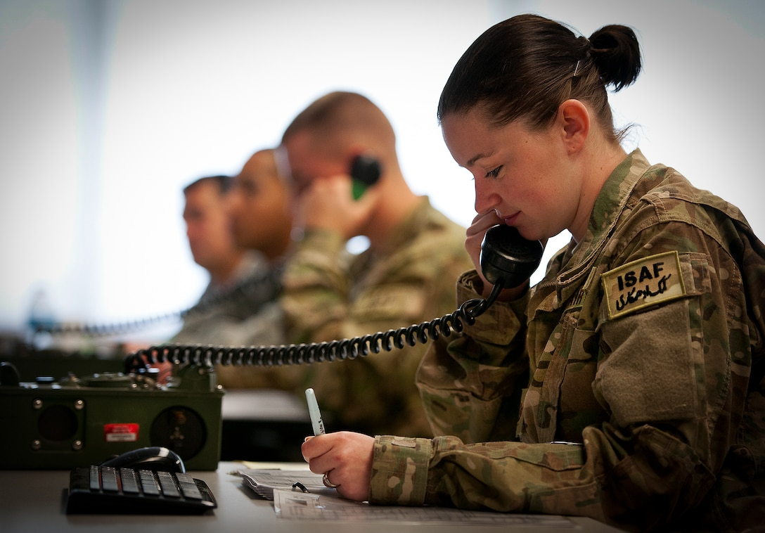 Staff Sgt. Danielle Keister, of the 460th Security Forces Squadron from Buckley Air Force Base, Colo., serves as the watch keeper, passing information via a secure phone during a Joint Defense Operations Center exercise at Eglin AFB, Fla., May 4.  The exercise simulated real-world force protection conditions at Kandahar Air Field, Afghanistan, to help deployers have specific location training before arriving to their new assignment.  The training was facilitated by the 96th Ground Combat Squadron.  (U.S. Air Force photo/Samuel King Jr.)