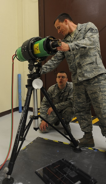 Staff Sgt. Joseph Swanson, 131st Maintenance Squadron non-destructive inspection craftsman, and Joel Flowers, 509th Maintenance Squadron NDI journeyman, set up an x-ray machine at Whiteman Air Force Base, Mo., May 1, 2013. The 131st and 509th NDI members have been officially integrated since 2009, but have been working together on aircraft since 2008. (U.S. Air Force photo by Airman 1st Class Bryan Crane)