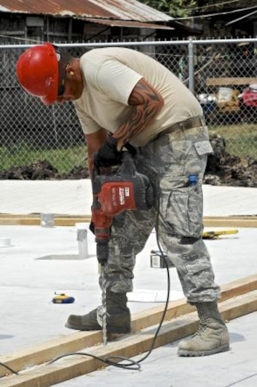 Staff Sgt. Donald King, assigned to the 7th Logistics Readiness Squadron, drills anchor holes into the concrete foundation April 30, 2013, at the Trial Farm Government School construction site in Orange Walk, Belize. Civil engineers from both the U.S. and Belize are constructing various structures at schools throughout Belize as part of an exercise called New Horizons. Building these facilities will support further education for the children of the country and provide valuable training for U.S. and Belizean service members. (U.S. Air Force photo/ Master Sgt. James Law)