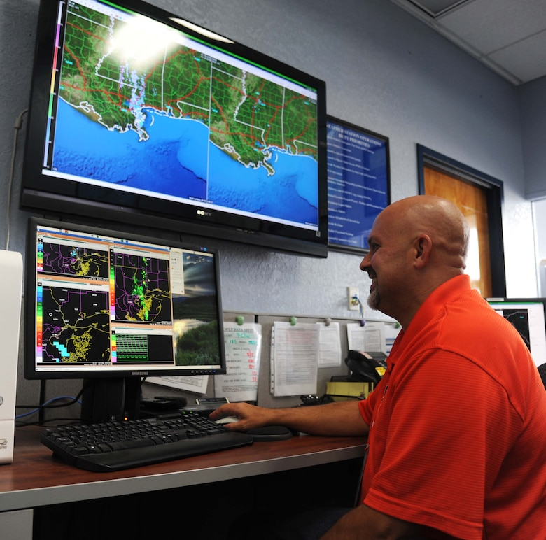 Jeffrey Light, 81st Operations Support Flight weather forecaster, views doplar radar images May 3, 2013, at base operations, Keesler Air Force Base, Miss.  Airfield Operators perform and manage airfield operations functions and activities including air traffic control, airfield management, and base operations to facilitate the flying mission at their base. They provide staff supervision and technical assistance, as well as develop and formulate plans and policies for managing and operating Air Force airfield operations.  (U.S. Air Force photo by Kemberly Groue)