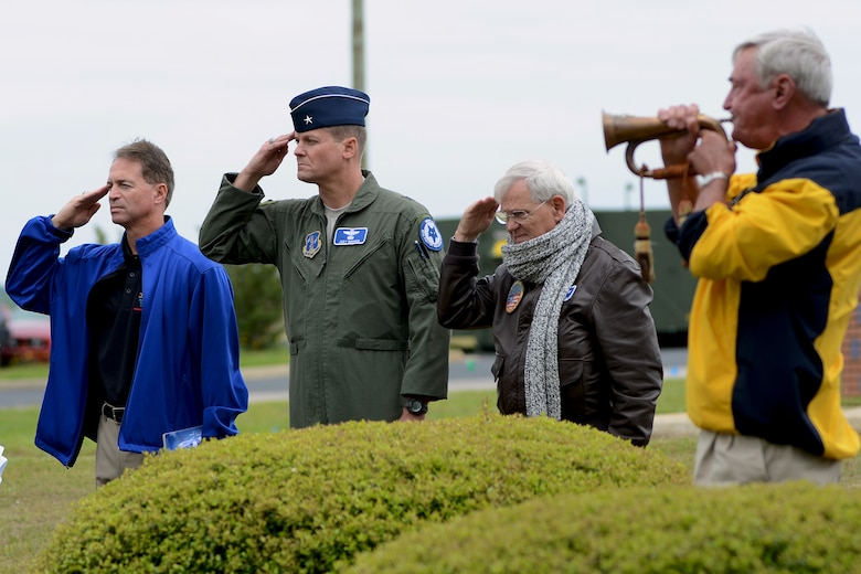 U.S. Air Force retired fighter pilots from the South Carolina Air National Guard, salute the U.S. flag as taps is played during a pilot reunion ceremony at McEntire Joint National Guard Base, Eastover, S.C., May 4, 2013. Multi-generation SCANG pilots dating back from the P-51 propeller fighter era to present converged to honor fallen comrades and celebrate their experiences and contributions to fighter operations and the legacy of the SCANG Swamp Foxes.  (U.S. Air National Guard photo by Tech. Sgt. Caycee Watson/Released)