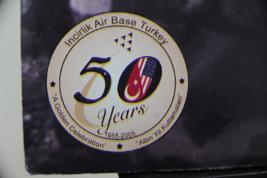 A graphic on a poster board commemorating Incirlik Air Base celebrating its 50th anniversary in 2005 sits at the top of a flight of stairs in the 39th Air Base Wing headquarters building at Incirlik Air Base, Turkey, May 2, 2013. Local sources have confirmed this picture has been on display for the past eight years. (U.S. Air Force photo by 1st Lt. David Liapis/Released)
