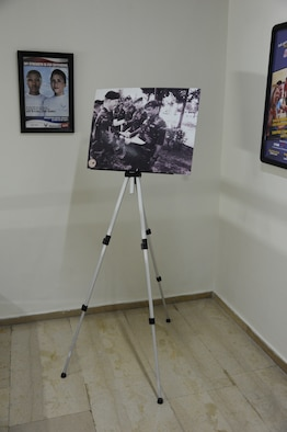 A poster board celebrating the 50th anniversary of Incirlik Air Base that took place in 2005 sits at the top of a flight of stairs in the 39th Air Base Wing headquarters building at Incirlik Air Base, Turkey, May 2, 2013. Local sources have confirmed this picture has been on display for the past eight years. (U.S. Air Force photo by 1st Lt. David Liapis/Released)