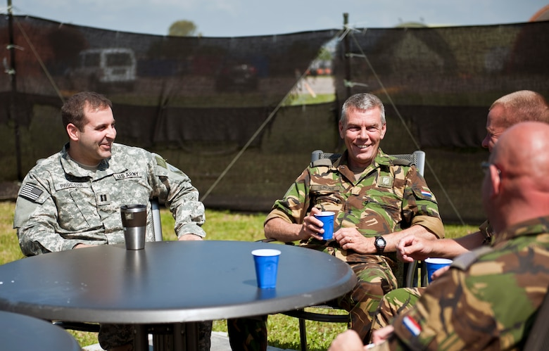 U.S. Army Capt. Adam Proctor, 1st Netherlands Ballistic Missile Defense Task Force Dutch missile systems tactical director, enjoys a coffee break with Dutch army soldiers  April 26, 2013, at Incirlik Air Base, Turkey. Though Proctor is part of the U.S. military, he is currently assigned to the Dutch military as a foreign exchange officer and deployed to Incirlik as part of the NATO commitment to deter hostile actions near the Turkish-Syrian border. (U.S. Air Force photo by Senior Airman Daniel Phelps/Released)