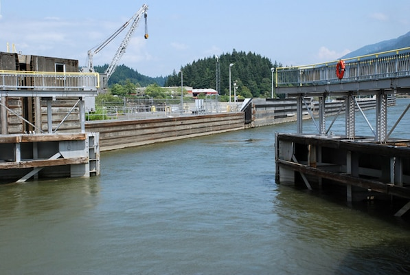 Commercial and recreational vessels enter the downstream navigation lock at Bonneville Dam on the Columbia River. Ten million tons of commercial cargo, valued at between $1.5 billion and $2 billion, is transported each year along the Columbia-Snake rivers navigation system, according to navigation industry data.