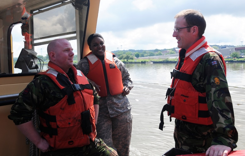 Capt. Matthew Fry (left), Sgt. 1st Class Solitaire Washington (center), and Maj. Robert Duke (right) board the U.S. Army Corps of Engineers, Baltimore District's Debris Vessel 1 in Washington Harbor as part of an Officer's Professional Development training.