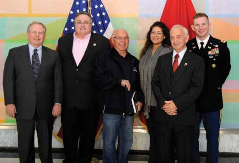Left to Right, Robert Dunn, John Berrey, Quapaw tribal elder Ranny McWaters, Delaware Nation THPO Tamara Francis Fourkiller, Jimmy McNeil and Col. Vernie Reichling at the Programmatic Agreement signing Nov. 20, 2012.