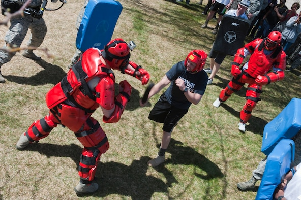 U.S. Air Force Master Sgt. Ryan Glosson, 366th Security Forces Squadron first sergeant, fights off Red Men to earn a security forces beret and title of Honorary Defender, April 26, 2013 at Mountain Home Air Force Base, Idaho. Glosson completed four challenges – to earn his beret. (U.S. Air Force photo/Staff Sgt. Roy Lynch/Released)