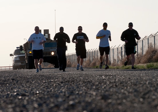 Members of the 366th Security Forces Squadron run the base perimeter, April 26, 2013 at Mountain Home Air Force Base, Idaho. The run is part of for physical exercises to induct the SFS first sergeant as an Honorary Defender.  (U.S. Air Force photo/Staff Sgt. Roy Lynch/Released)