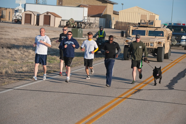 Members of the 366th Security Forces Squadron run the base perimeter, April 26, 2013 at Mountain Home Air Force Base, Idaho. The run is part of for physical exercises to induct the SFS first sergeant as an Honorary Defender. (U.S. Air Force photo/Staff Sgt. Roy Lynch) (Released)