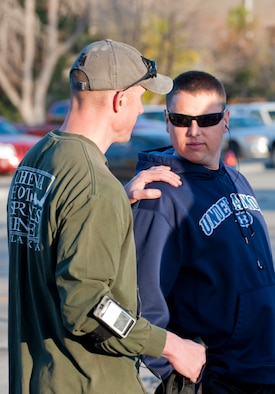 U.S. Air Force Maj. Ryan Bodge, 366th Security Forces commander, speaks with Master Sgt. Ryan Glosson, 366th SFS first sergeant, before a 10-mile perimeter run, April 26, 2013 at Mountain Home Air Force Base, Idaho. This was one of several ways Glosson was tested to see if he had what it takes to be an Honorary Defender. (U.S. Air Force photo/Staff Sgt. Roy Lynch/Released)