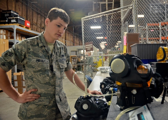 Missouri Air National Guard Senior Airman Jeremiah Pressly, of the 131st Logstics Readiness Squadron, tests gas masks that will be issued members of the 131st Bomb Wing during the unit training assembly May 4. (U.S. Air National Guard photo by Staff Sgt. Sean Navarro/RELEASED)