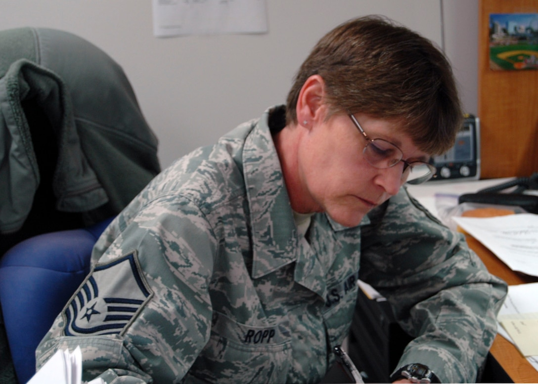 Missouri Air National Guard Master Sgt. Cheryl Ropp, of the 131st Bomb Wing, completes paperwork during drill weekend to ensure military entitlements are processed on time at Whiteman Air Force Base, Mo., May 5.  (U.S. Air National Guard photo by Staff Sgt. Traci Payne/RELEASED)