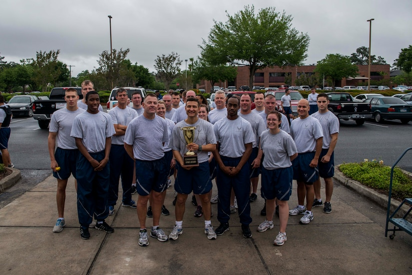 Members of the 628th Logistics Readiness Squadron pose for a group photo after the Commander's Challenge Run May 3, 2013, at Joint Base Charleston – Air Base, S.C. The Commander's Challenge is held monthly to test Team Charleston's fitness abilities. The Spirit Award was given to the 628th LRS. (U.S. Air Force photo/ Senior Airman George Goslin)