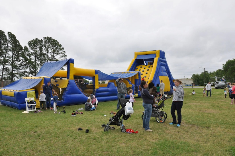 Service members and their families enjoy the food and outdoor activities at the Joint Base Charleston Picnic May 4, 2013. The base picnic was a free two-day event which included free food, drinks and a live band for all Team Charleston members and their families to enjoy. (U.S. Air Force photo/Senior Airman Bobby Pilch)