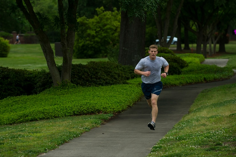 Senior Airman Matthew Knopf, 628th Medical Group health service  management technician, pushes towards the finish line during the Commander's Challenge Run May 3, 2013, at Joint Base Charleston – Air Base, S.C. The Commander's Challenge is held monthly to test Team Charleston's fitness abilities. Knopf was the top male runner with a time of 18:57. (U.S. Air Force photo/ Senior Airman George Goslin)