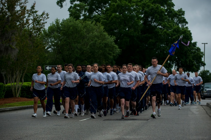 Members of the 628th Logistics Readiness Squadron run in formation during the Commander's Challenge Run May 3, 2013, at Joint Base Charleston – Air Base, S.C. The Commander's Challenge is held monthly to test Team Charleston's fitness abilities. (U.S. Air Force photo/ Senior Airman George Goslin)