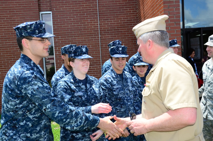 Navy Capt. Tom Bailey, Joint Base Charleston deputy commander, thanks Sailors for their support during the Weapons Station Branch Library move May 7, 2013, at Joint Base Charleston – Weapons Station, S.C.  Twenty-five Sailors helped move books, furniture and equipment from the library, saving the 628th Air Base Wing more than $90,000. (U.S. Air Force photo/Staff Sgt. Anthony Hyatt)