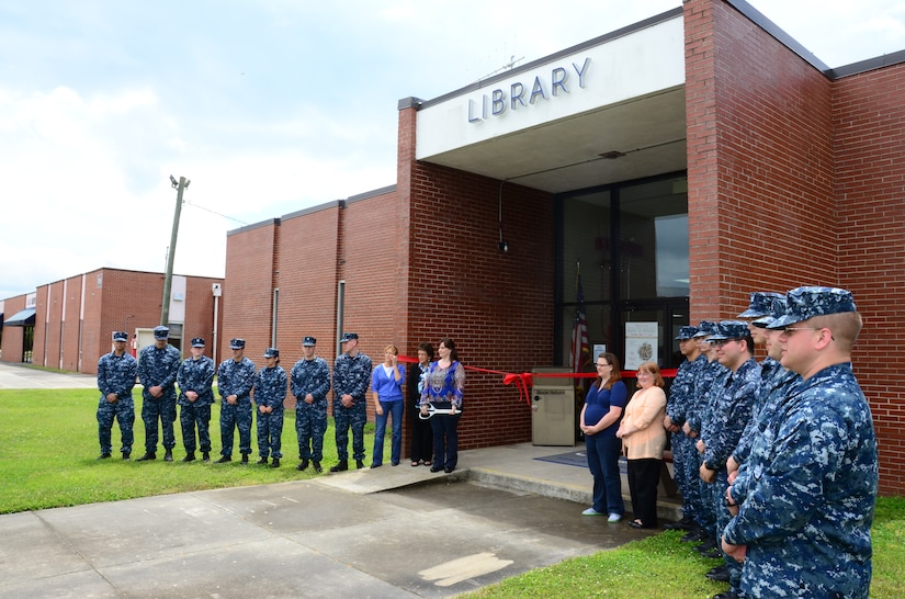 Sailors and staff members await the ribbon-cutting ceremony for the Weapons Station Branch Library May 7, 2013, at Joint Base Charleston – Weapons Station, S.C. Twenty-five Sailors helped move books, furniture and equipment from the library, saving the 628th Air Base Wing more than $90,000. (U.S. Air Force photo/Staff Sgt. Anthony Hyatt)