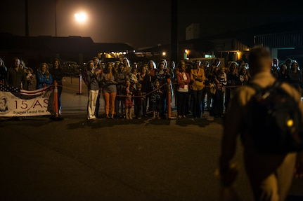 Family members of Airmen from the 15th Airlift Squadron wait in front of the 437th Airlift Wing Passenger Terminal for their Airmen to return home May 4, 2013, at Joint Base Charleston – Air Base, S.C. The squadron flew 1,000 sorties while safely moving 40 million pounds of cargo and 5,000 passengers throughout the area of responsibility. The squadron also precisely executed 33 combat airdrops resupplying forward operating bases throughout Southwest Asia with 900 bundles of supplies. (U.S. Air Force photo/ Senior Airman Dennis Sloan)