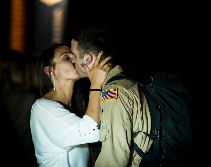 1st Lt. Jordan Novotny, 15th Airlift Squadron C-17 Globemaster III pilot, kisses his wife Rebecca May 4, 2013, at Joint Base Charleston – Air Base, S.C., after returning home from a two-month deployment to Southwest Asia. The squadron flew 1,000 sorties while safely moving 40 million pounds of cargo and 5,000 passengers throughout the area of responsibility. The squadron also precisely executed 33 combat airdrops resupplying forward operating bases throughout Southwest Asia with 900 bundles of supplies. (U.S. Air Force photo/ Senior Airman Dennis Sloan)