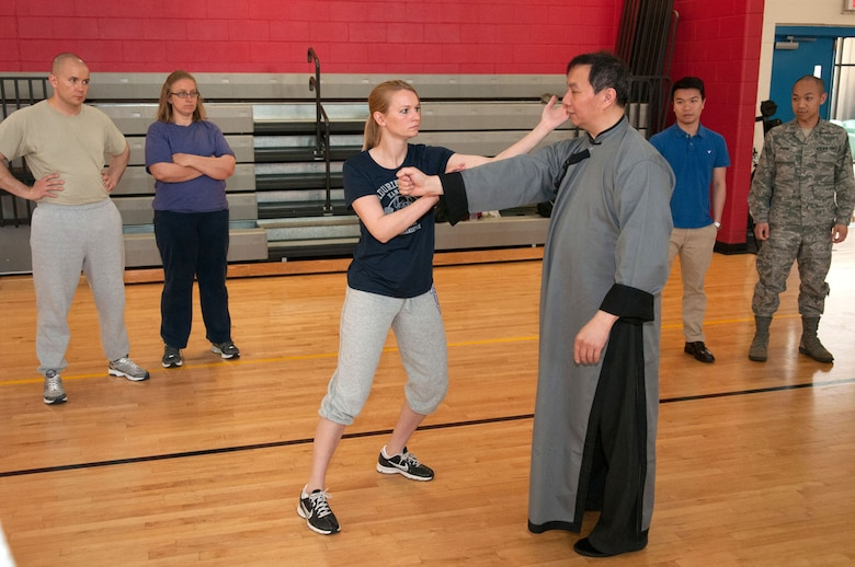 HANSCOM AIR FORCE BASE, Mass. – Sifu Stanley Jue instructs Capt. Brandy Wade during a martial arts demonstration and class at the Hanscom Sports and Fitness Center May 8 as part of Asian Pacific American Heritage Month. Wing Chun is a unique and effective martial art that was originally developed for women to compete against larger and stronger competitors. (U.S. Air Force photo by Rick Berry