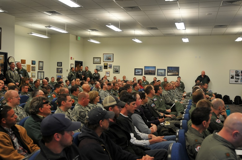 U.S. Air Force Col. Steve Rader, commander of the 153rd Airlift Wing, Wyoming Air National Guard, welcomes members from the 145th Airlift Wing, North Carolina Air National Guard and representatives from 302nd Airlift Wing and 146th Airlift Wing at the beginning of the annual Modular Airborne Fire Fighting System training for certification held at the Cheyenne Regional Airport, Cheyenne, Wyo., May 6, 2013. (U.S. Air National Guard photo by Tech. Sgt. Patricia Findley/Released)
