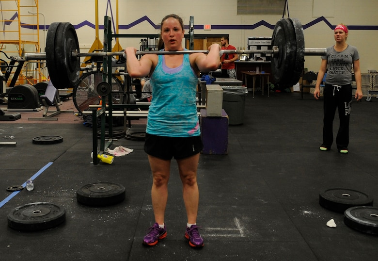 Staff Sgt. Samantha Scott, 509th Bomb Wing Command Post training manager, performs a max clean deadlift as her last event in the K-State CrossFit Challenge in Manhattan, Kan., April 27, 2013.  She placed third overall in the women's scaled division.  (U.S. Air Force photo by Staff Sgt. Alexandra M. Boutte/Released)