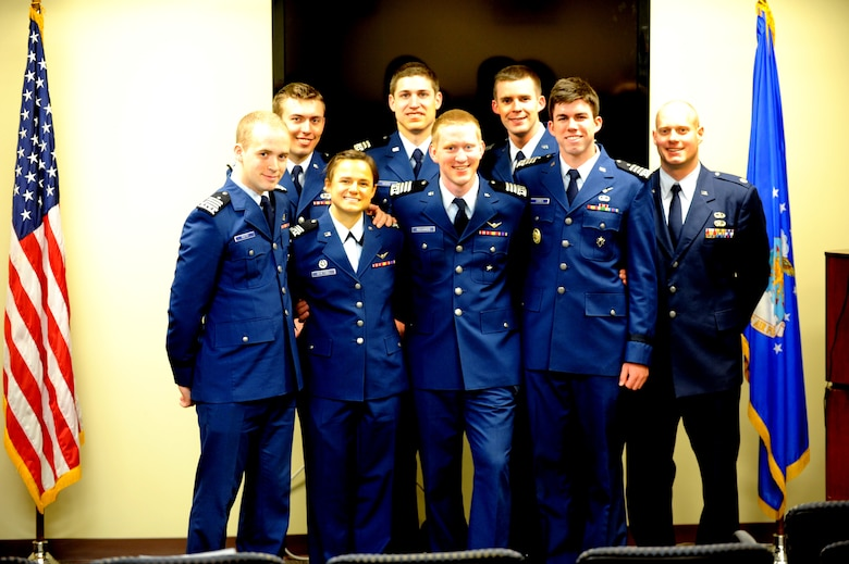 Seven senior cadets from the Air Force Academy presented their final patient loading prototype to 375th Aeromedical Evacuation Squadron members May 3 at Scott AFB.  Back row: Jared Rillings, Matt Hein, Brad Phelan, Maj. Cody Rasmussen.  Front row: Fred Rath, Jenna Whetsel, Hayden Richards, Tyler Ogren. (U.S. Air Force Photo by Staff Sgt. Maria Bowman)