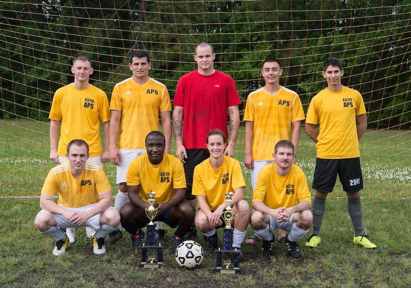 The 437th Aerial Port Squadron intramural soccer team gathers for a group photo after the championship game May 2, 2013, at Joint Base Charleston – Air Base, S.C.. The 628th LRS soccer team defeated the 437th APS soccer team 8 – 2 in Joint Base Charleston's 2013 intramural soccer championship game. (U.S. Air Force photo/Staff Sgt. Rasheen Douglas)