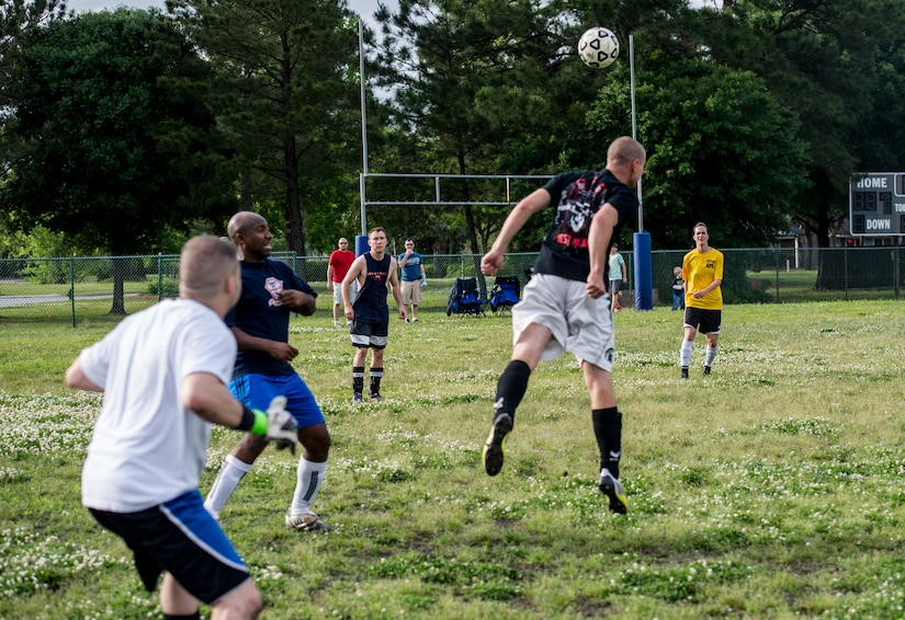 Airman 1st Class Kyle Jones, 628th Logistics Readiness Squadron intramural soccer team player, heads a soccer ball to keep possession away from the 437th Aerial Port Squadron intramural soccer team May 2, 2013, at Joint Base Charleston – Air Base, S.C. The 628th LRS soccer team defeated the 437th APS soccer team 8 – 2 in Joint Base Charleston's 2013 intramural soccer championship game. (U.S. Air Force photo/Staff Sgt. Rasheen Douglas)