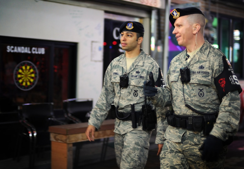 Tech. Sgt. Christopher Cermeli, 51st Security Forces Squadron town patrol NCO in charge, and Master Sgt. Anthony Ford, 51st SFS town patrol superintendent, patrol the Songtan Entertainment District outside of Osan Air Base, Republic of Korea, May 4, 2013. Town patrol members work with the Korean National Police to uphold law enforcement standards for three kilometers, or 1.8 miles, from anywhere outside of the base. Patrol teams ensure Department of Defense personnel are abiding by all of the local and military rules and regulations when in their area of responsibility. (U.S. Air Force photo/Staff Sgt. Sara Csurilla)