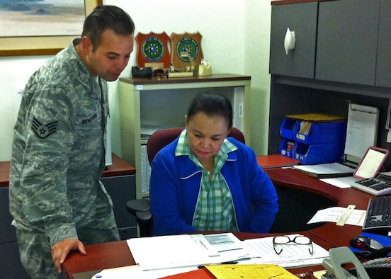 Staff Sgt. Ernest Benavides, 36th Mission Support Group Detachment 1 Materiel Management NCO in charge, and Elizabeth Del Pilar, 36th MSG Det. 1 budget analyst, review records at Diego Garcia May 1, 2013. Del Pilar has been the 36th MSG's lone off-shore Philippine general schedule employee since 2004. (U.S. Air Force courtesy photo)
