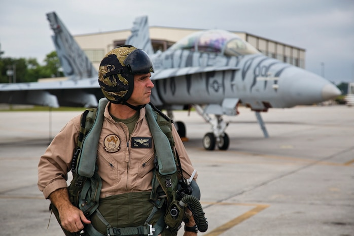 Lt. Col. Peter McArdle, Marine All Weather Fighter Attack Squadron (VMFA(AW)224) commanding officer, prepares for his last flight with VMFA(AW)-224 aboard Marine Corps Air Station Beaufort, SC, May 1, 2013. Lt. Col. McArdle relinquished his command to Lt. Col. Raymond Ayres, III on May 2, 2013. (Official Marine Corps photo by Lance Cpl. Donald Holbert)