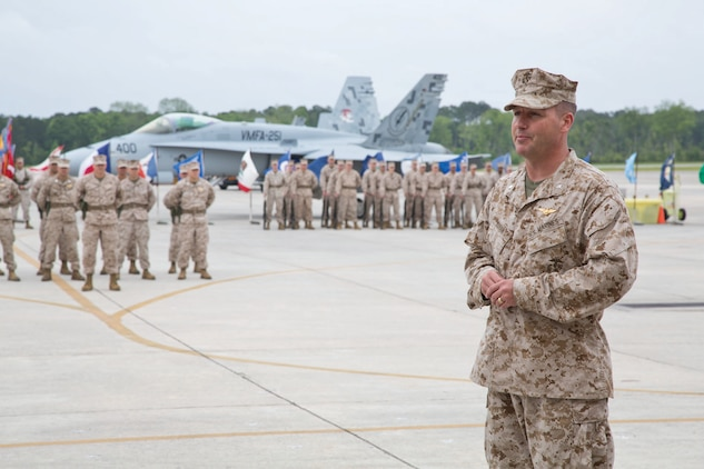 Lt. Col. Joshua Riggs, Marine Fighter Attack Squadron 251 commanding officer, relieves Lt. Col. Simon Doran during a change and command ceremony, May 3. Doran will continue his career as a post-graduate student at the Air Warfare College.
