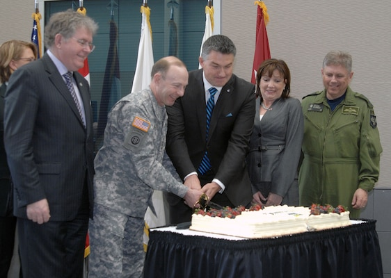 PETERSON AIR FORCE BASE, Colo. - North American Aerospace Defense Command leadership and members of the Canadian government cut the NORAD 55th anniversary cake during a ceremony at the command's headquarters here May 9, 2013. From left to right: Jack Harris, vice chair of the Canadian Standing Committee on National Defence; Army Gen. Chuck Jacoby, commander of NORAD and U.S. Northern Command; James Bezan, Chairman of the NDDN; Marcy Grossman, Consul General of Canada in Denver; and Canadian Lt.-Gen. Alain Parent, deputy commander of NORAD.