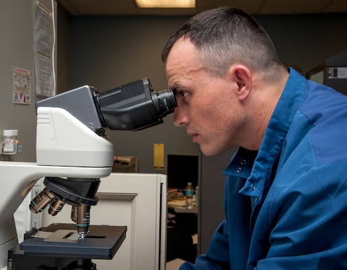 Tech. Sgt. Edgar Ferreira, 47th Medical Support Squadron NCO in charge of laboratory operations, looks through a microscope at Laughlin Air Force Base, Texas, May 8, 2013. The American Nurses Association and Laughlin have declared the week of May 6 through 12 as National Nurses and Technicians Week to celebrate the safe, high quality care provided to patients. (U.S. Air Force photo/Airman 1st Class John D. Partlow)