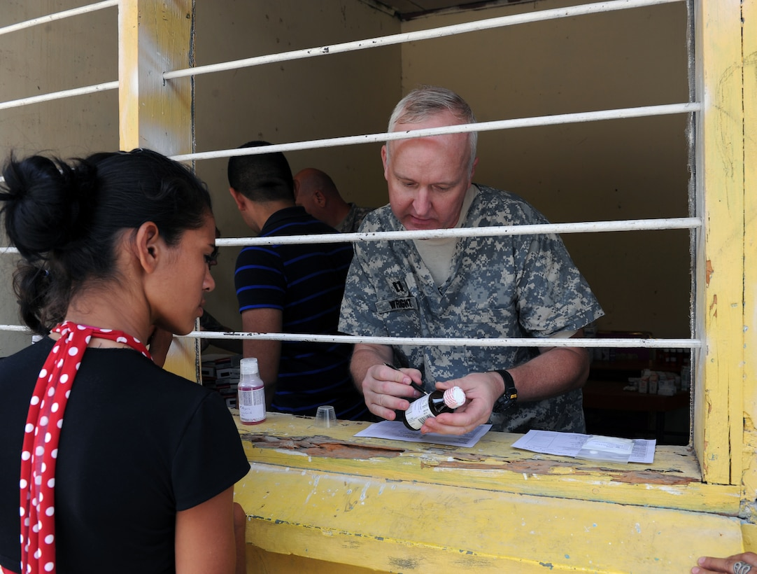 U.S. Army Capt. Philip Wright, Joint Task Force-Bravo Pharmacist, explains how to take the medication to a patient during a  Medical Readiness exercise, May 6. Joint Task force-Bravo partnered with Honduran Ministry of Health and Honduran military personnel, to provide medical services to more than 500 Cuesta de la Virgen community members. (Photo by Martin Chahin)