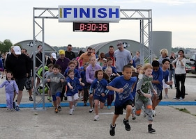 """DAYTON, Ohio (05/2013) -- Participants get ready for the 1-mile kids' fun run, which orbited """"Jupiter,"""" during Space Fest on May 4 at the National Museum of the U.S. Air Force. (U.S. Air Force photo by Don Popp)"""